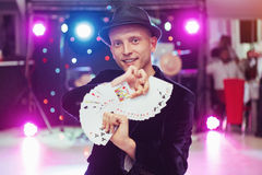Magician showing trick with playing cards. Magic, circus Stock Images