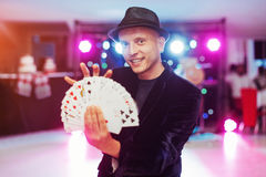Magician showing trick with playing cards. Magic, circus Royalty Free Stock Image