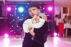 Magician showing trick with playing cards. Magic, circus Stock Photography