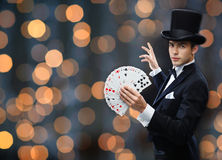 Magician showing trick with playing cards Royalty Free Stock Photo