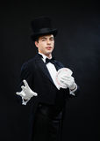 Magician showing trick with playing cards Stock Photography