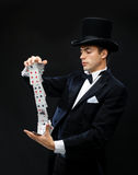 Magician showing trick with playing cards Royalty Free Stock Image