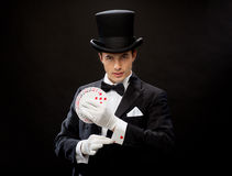 Magician showing trick with playing cards Royalty Free Stock Images