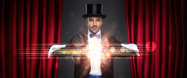 Magician showing trick. On stage, magic, performance, circus, show concept Stock Photos