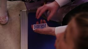 Magician shows tricks with cards.  stock video footage