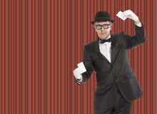 Magician. In stage costume showing card tricks Stock Photos