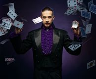 Magician in stage costume Stock Photo