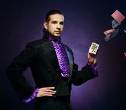 Magician in stage costume Stock Photography