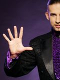 Magician in stage costume Stock Photos