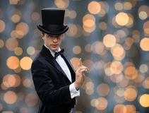 Magician in top hat pointing finger up Royalty Free Stock Image
