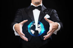 Magician in top hat showing globe hologram Stock Photo