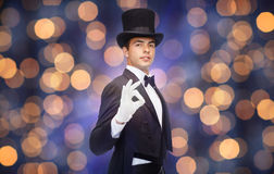 Magician in top hat showing ok hand sign Stock Photos
