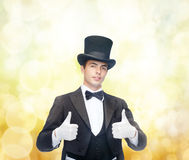Magician in top hat showing thumbs up Royalty Free Stock Photo