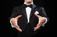 Magician in top hat showing trick Royalty Free Stock Photos