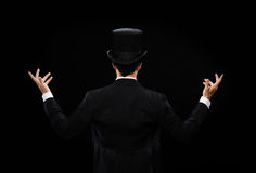 Magician in top hat showing trick from the back Royalty Free Stock Photography