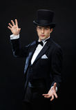 Magician in top hat showing trick Stock Image