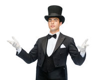 Magician in top hat showing trick Stock Images