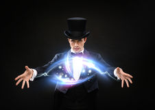 Magician in top hat showing trick. Magic, performance, circus, show concept - magician in top hat showing trick Stock Photography