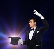 Magician in top hat showing trick Stock Photography