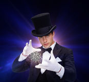 Magician in top hat showing trick Royalty Free Stock Photography