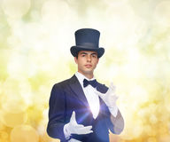 Magician in top hat showing trick Royalty Free Stock Image