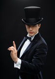 Magician in top hat showing trick Stock Photos