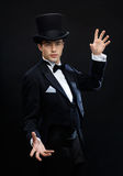 Magician in top hat showing trick Royalty Free Stock Photo