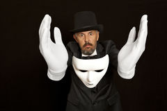 Magician in top hat showing trick. Magic, performance. Circus, show concept Royalty Free Stock Photo