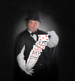 Magician with Trick Cards on Black Stock Photography