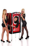Magician and two beauty girls in a magic box Royalty Free Stock Image