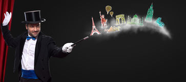 Magician using wand to traveling around world. Magician using wand with glowing landmarks from different cities- travel around the world royalty free stock photography