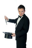 Magician with wand and hat Royalty Free Stock Photo