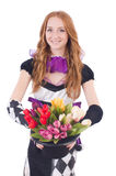 Magician woman with flowers Stock Photos