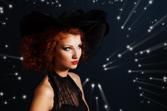 Magician woman. Portrait of an enchanting witch woman, beautiful and glamorous. Halloween Stock Photos