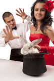 Magicians with  bunny. Closeup portrait of cute magicians with  bunny against white background Stock Photo