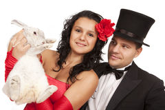 Magicians with  bunny. Closeup portrait of cute magicians with  bunny against white background Royalty Free Stock Photos