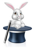 Magicians Bunny Rabbit. A cute cartoon magicians bunny rabbit coming out of a top hat with a magic wand Royalty Free Stock Photos