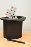 Magicians hat, and and cards Royalty Free Stock Photography