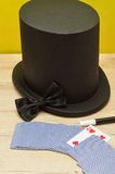 A magicians hat, wand, bow tie and a deck of cards Royalty Free Stock Images