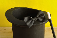 A magicians hat , wand and bow tie Royalty Free Stock Image