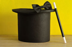 A magicians hat , wand and bow tie Stock Photo