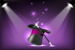Magicians hat and wand on stage lighting reflectors Royalty Free Stock Photos