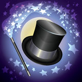 Wizards hat and a magic wand on stars background. Stock Photos