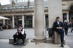 Magicians waiting for their turn to perform at Magic corner of Covent garden Royalty Free Stock Photos