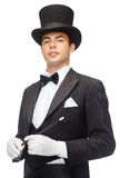 Magicien dans le chapeau supérieur avec le tour magique d'apparence de baguette magique Image libre de droits