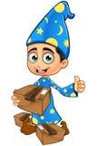 Magicien de garçon dans le bleu - tenir un colis Photo libre de droits