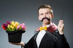 Magicien drôle avec la baguette magique Photo libre de droits