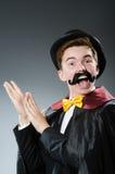 Magicien drôle avec la baguette magique Photos libres de droits