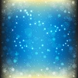 Magiczny Bożenarodzeniowy tło w błękicie barwi z olśniewającymi płatkami śniegu i gwiazdami Fotografia Stock