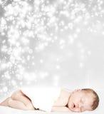 Magiczny zimy tło i sypialny dziecko Obrazy Royalty Free